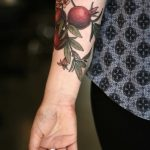 Pomegranate tattoo by Alice Carrier