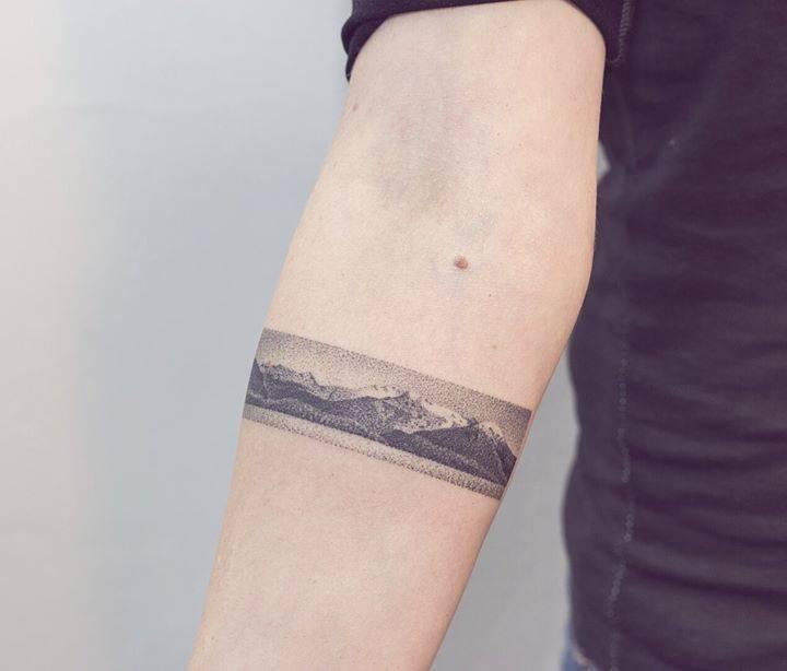 Realistic mountain landscape armband tattoo