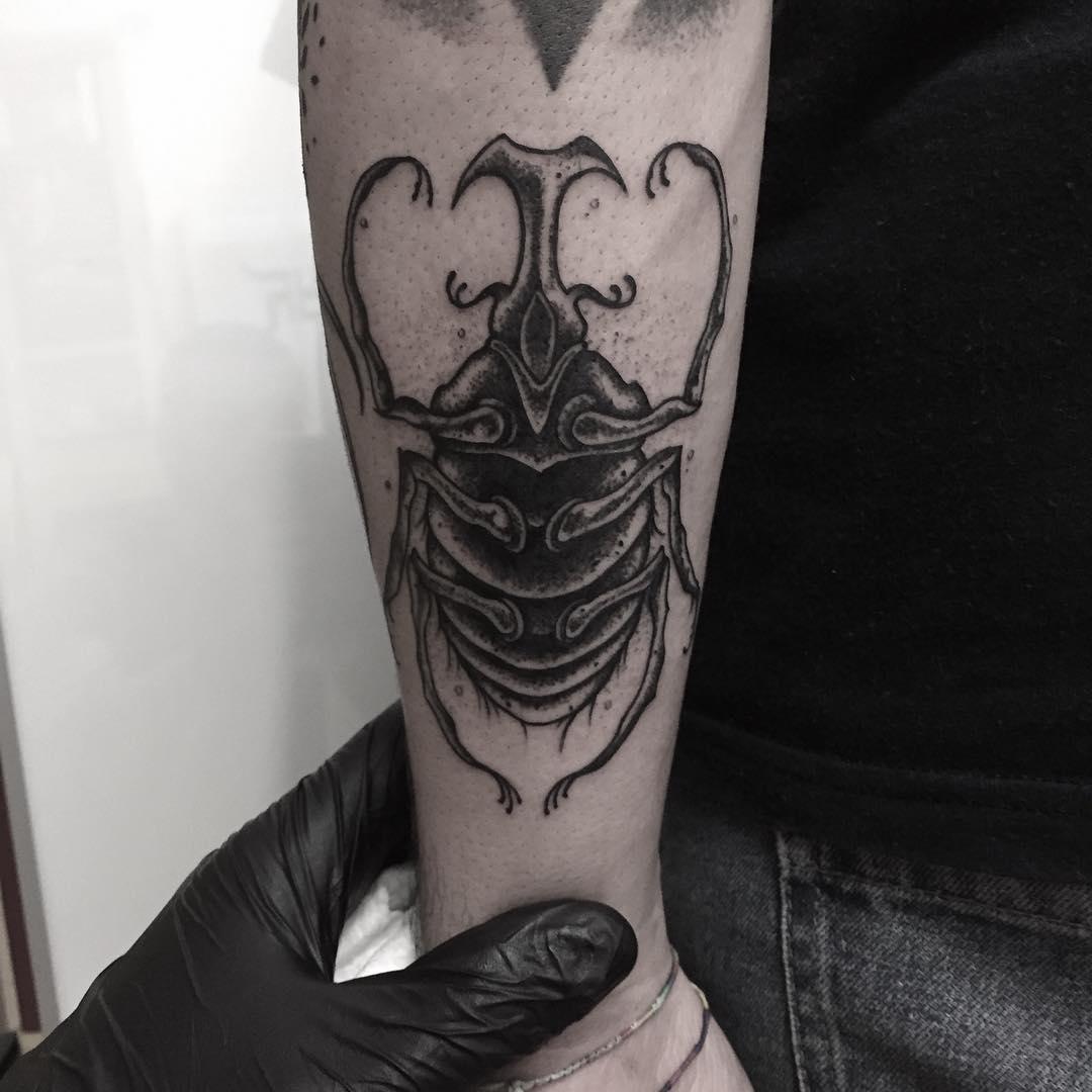 Rhino scarab tattoo