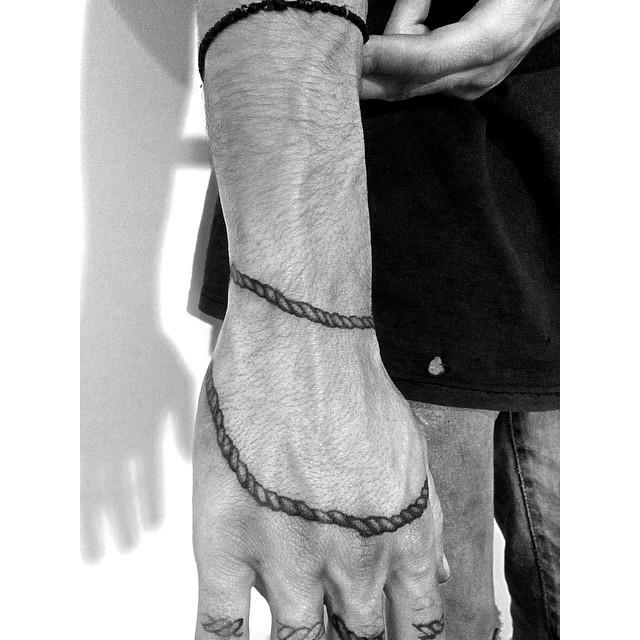 Rope tattoo around the hand