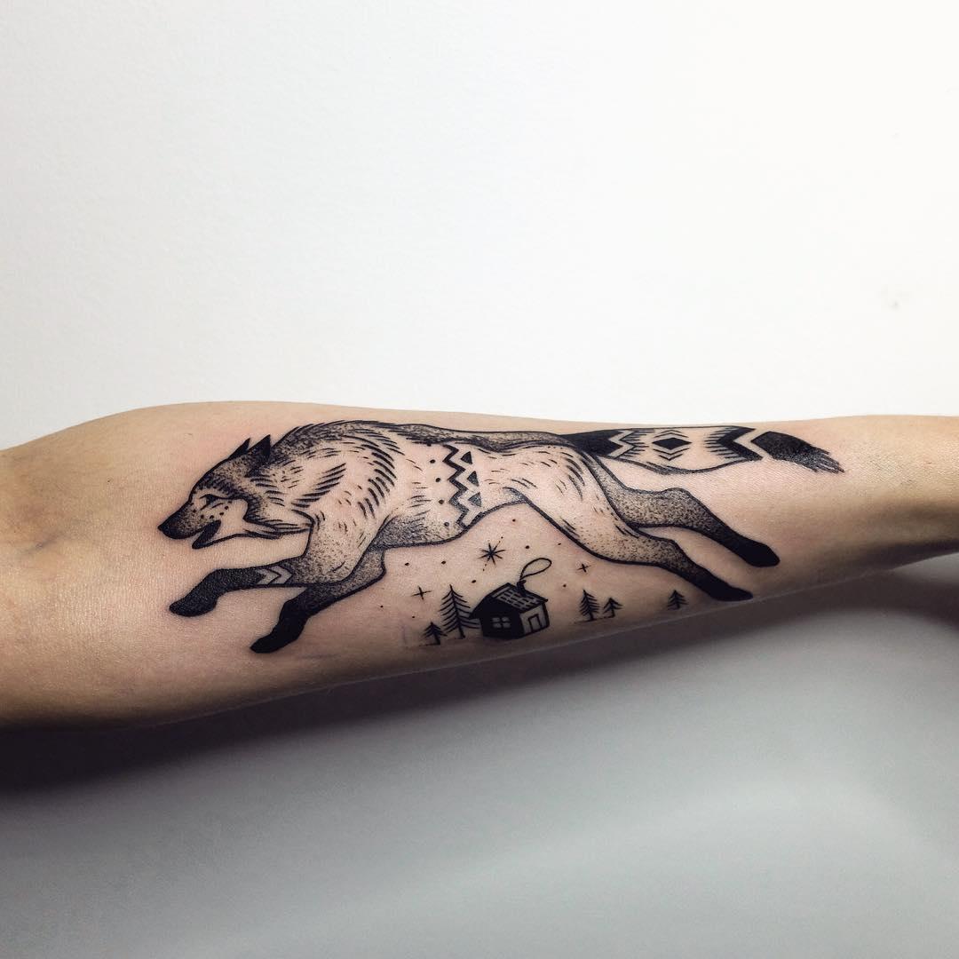 Running wolf tattoo by Sasha Tattooing