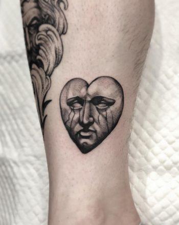Sad stone face done at Lighthouse Professional Tattoo
