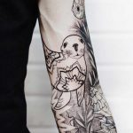 Seal and mandala tattoo