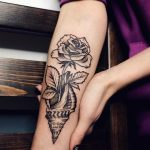 Shell and rose tattoo