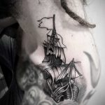 Ship tattoo on the left shoulder