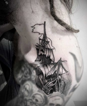 Ship tattoo on the left shoulder