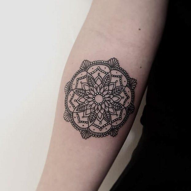 Simple and beautiful mandala on the forearm