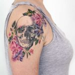 Skull and flowers on the right arm