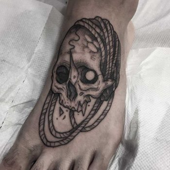 Skull and rope tattoos on foot