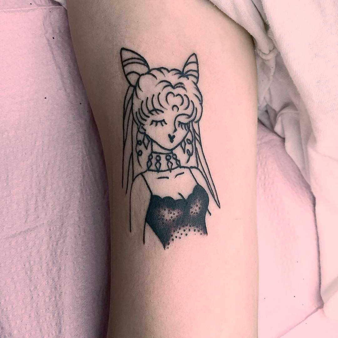 Small anime lady tattoo