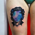 Space lady tattoo on the thigh