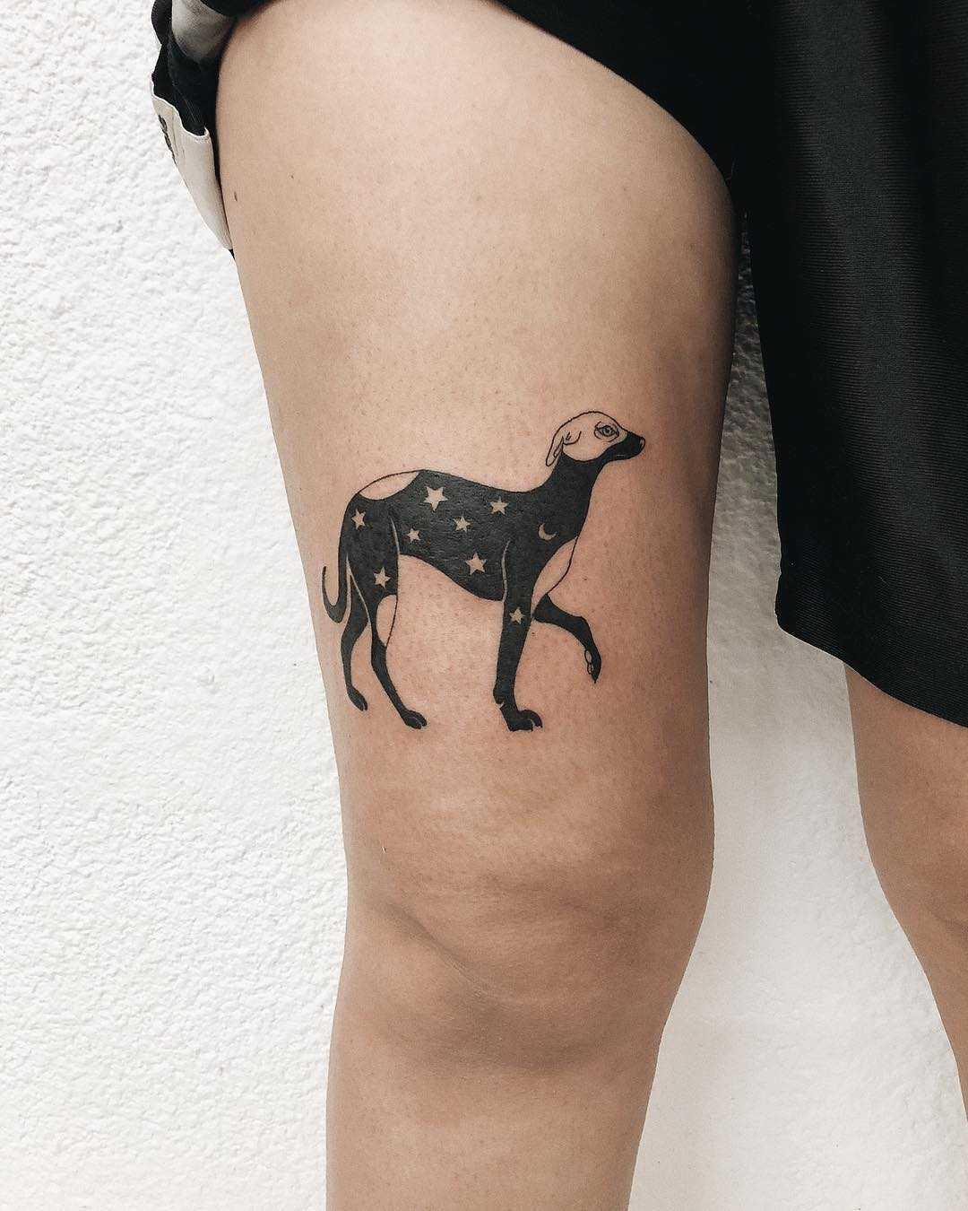 Starry dog tattoo