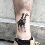 Tattoo of two giraffes