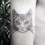 Three-eyed cat tattoo