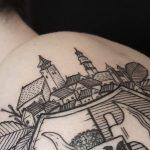Tiny city tattoo on the shoulder