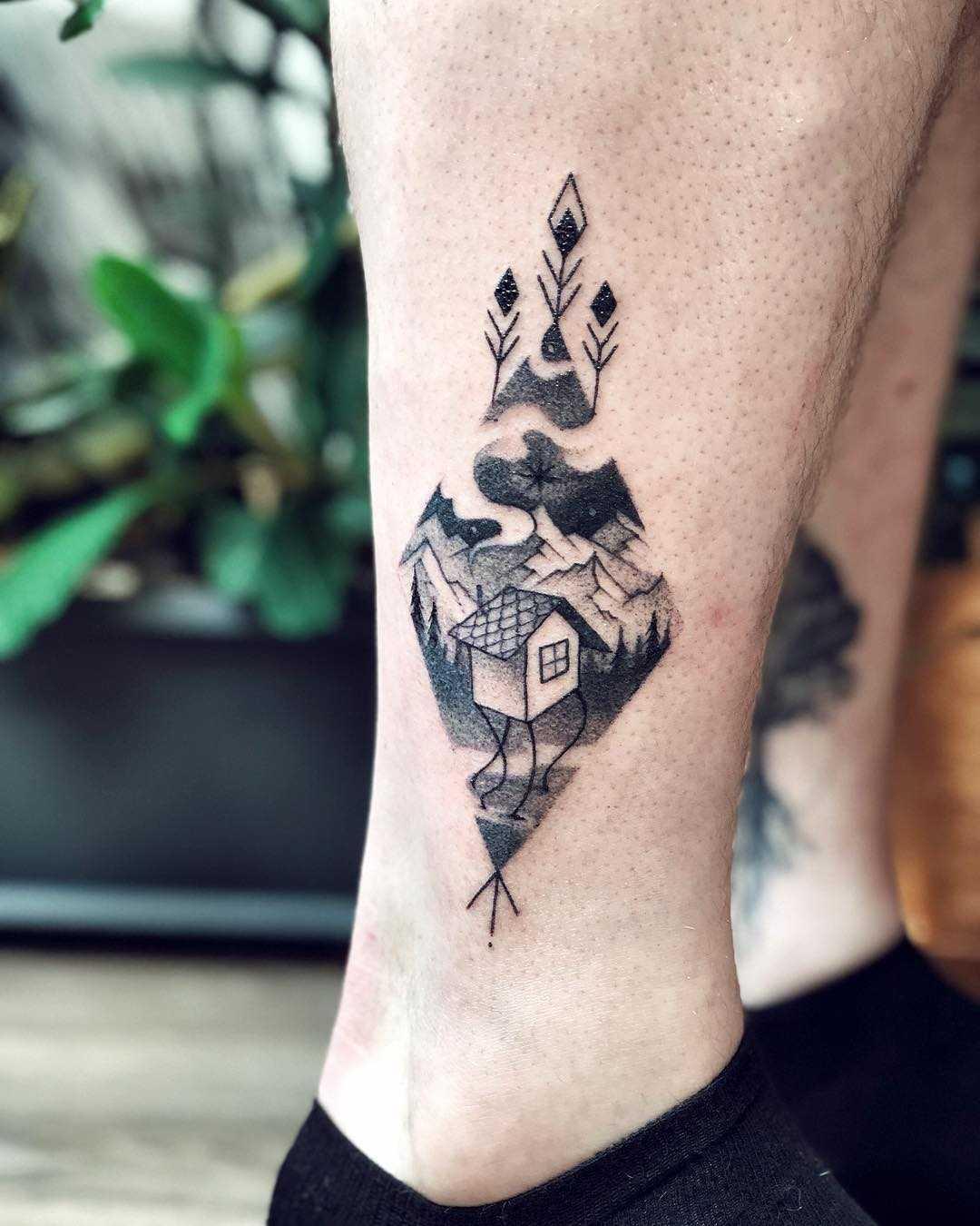 Triangular landscape on the calf by Sasha Tattooing