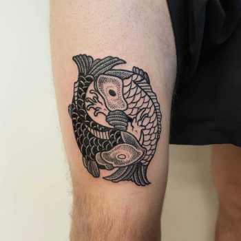 Two koi fish tattoo on the thigh