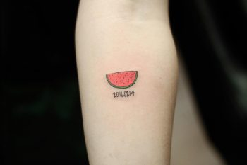 Watermelon slice tattoo by Yuni