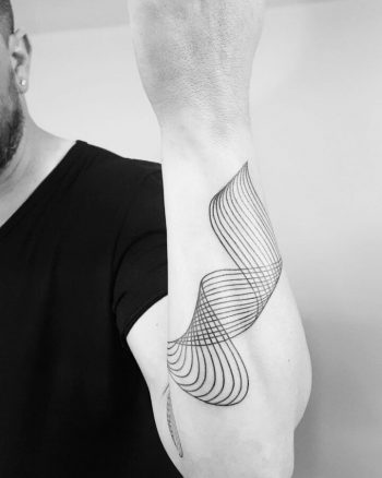Wavy lines tattoo