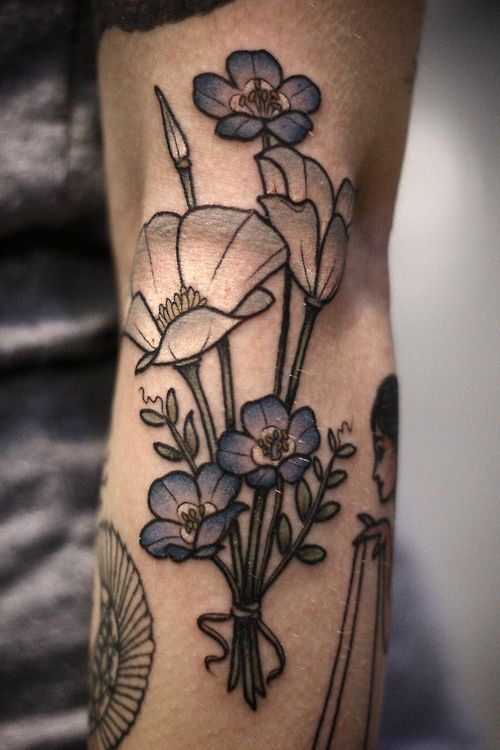 White and blue flower bouquet tattoo