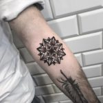 3D blackwork mandala tattoo