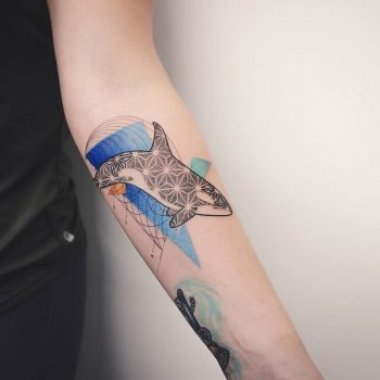 Abstract orca tattoo