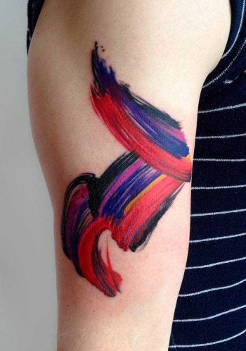 Abstract red and blue brushstroke tattoo