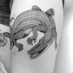 Alligator tattoo on the thigh
