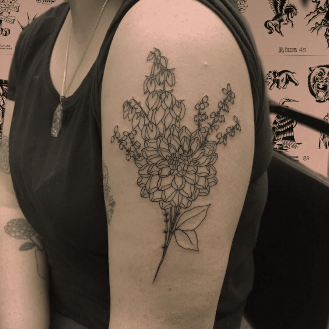 An arrangement of flowers tattoo