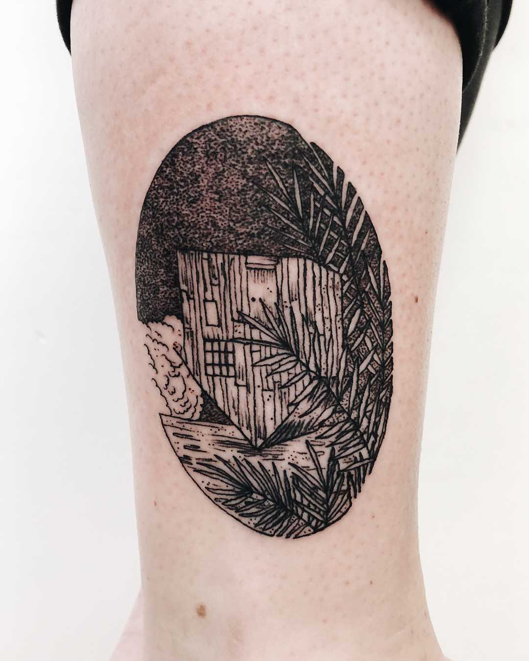 An upside down home tattoo