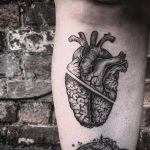 Anatomical blackwork heart and brain tattoo