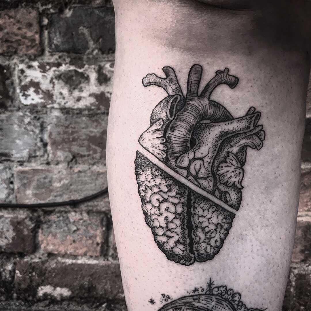 Anatomical blackwork heart and brain tattoo