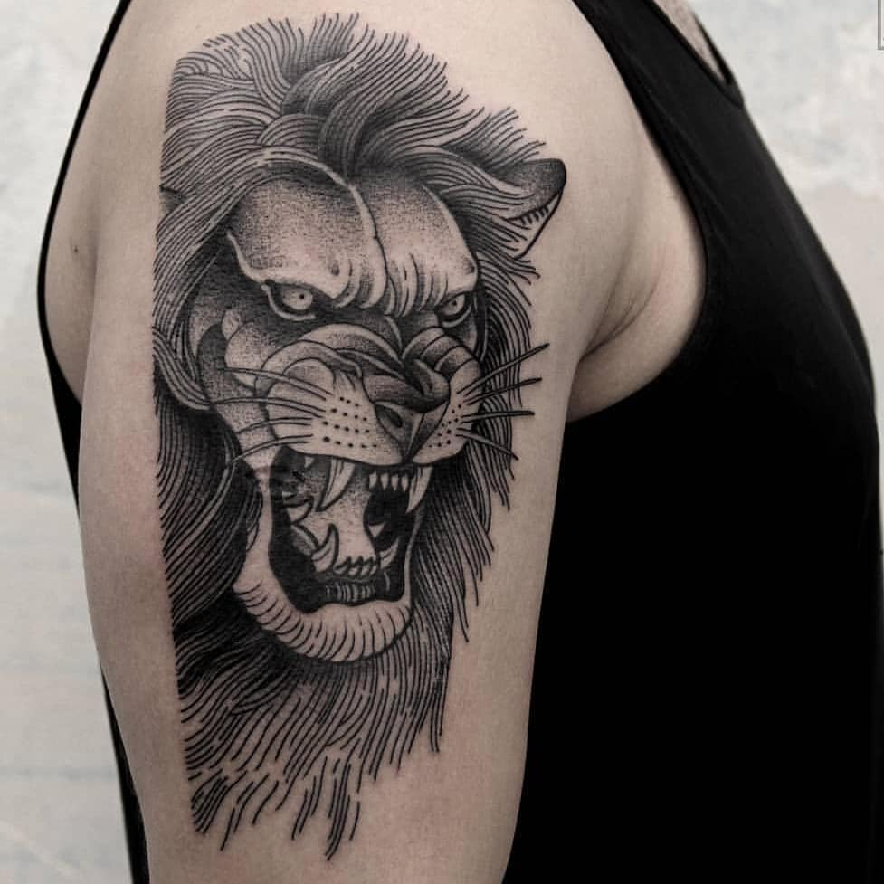 Angry lion tattoo on the right arm