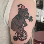 Bear on a bicycle by Jiran Tattoo