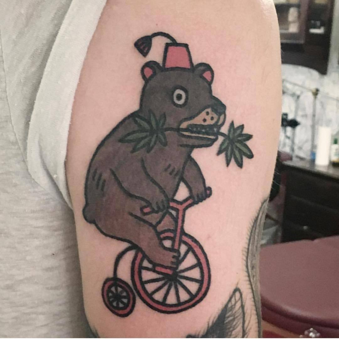 Bear on a bicycle by Jiran Tattoo