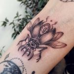 Black beetle tattoo