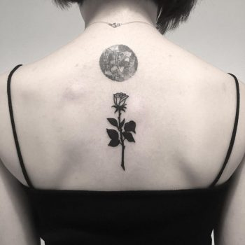 Black rose and full moon tattoo on the back