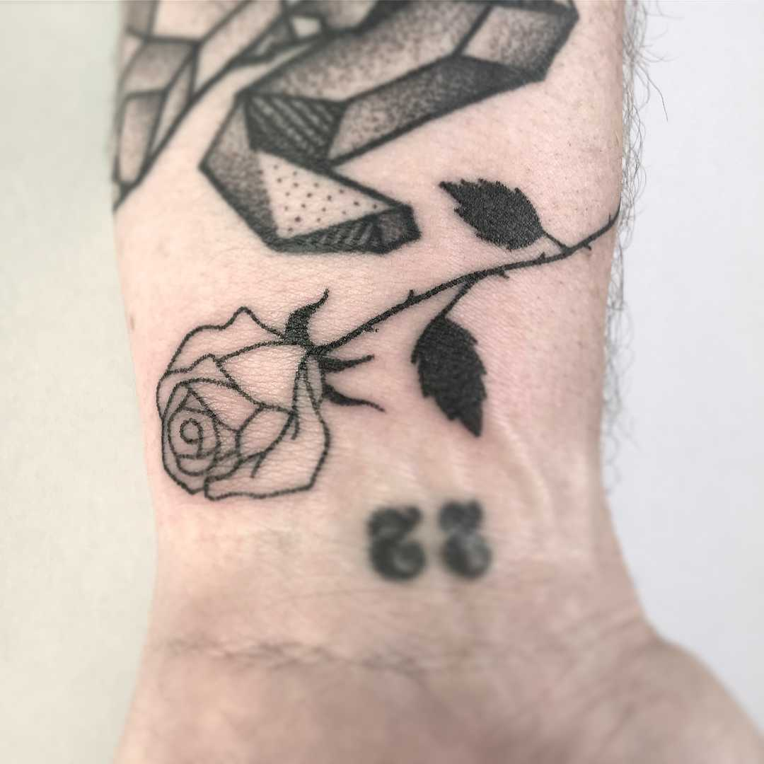Black rose on the wrist by Femme Fatale Tattoo