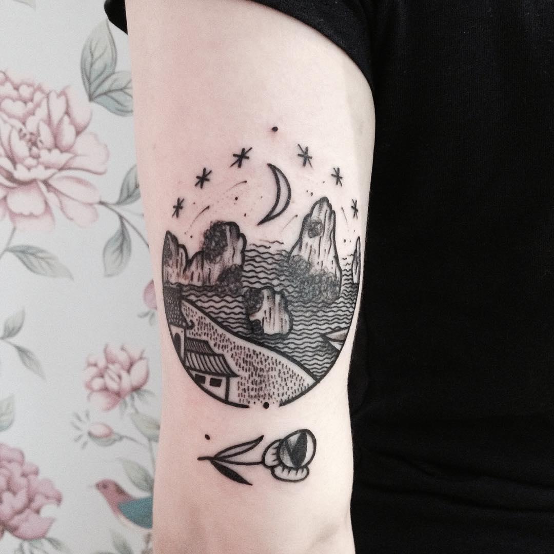 Blackwork landscape and rose tattoo