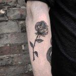 Blackwork rose stem tattoo
