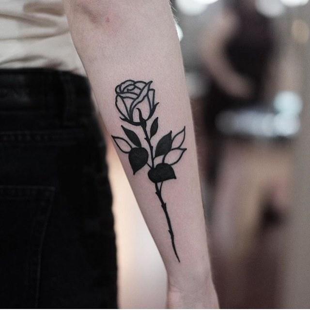 Blackwork rose tattoo on the forearm by Jonas Ribeiro