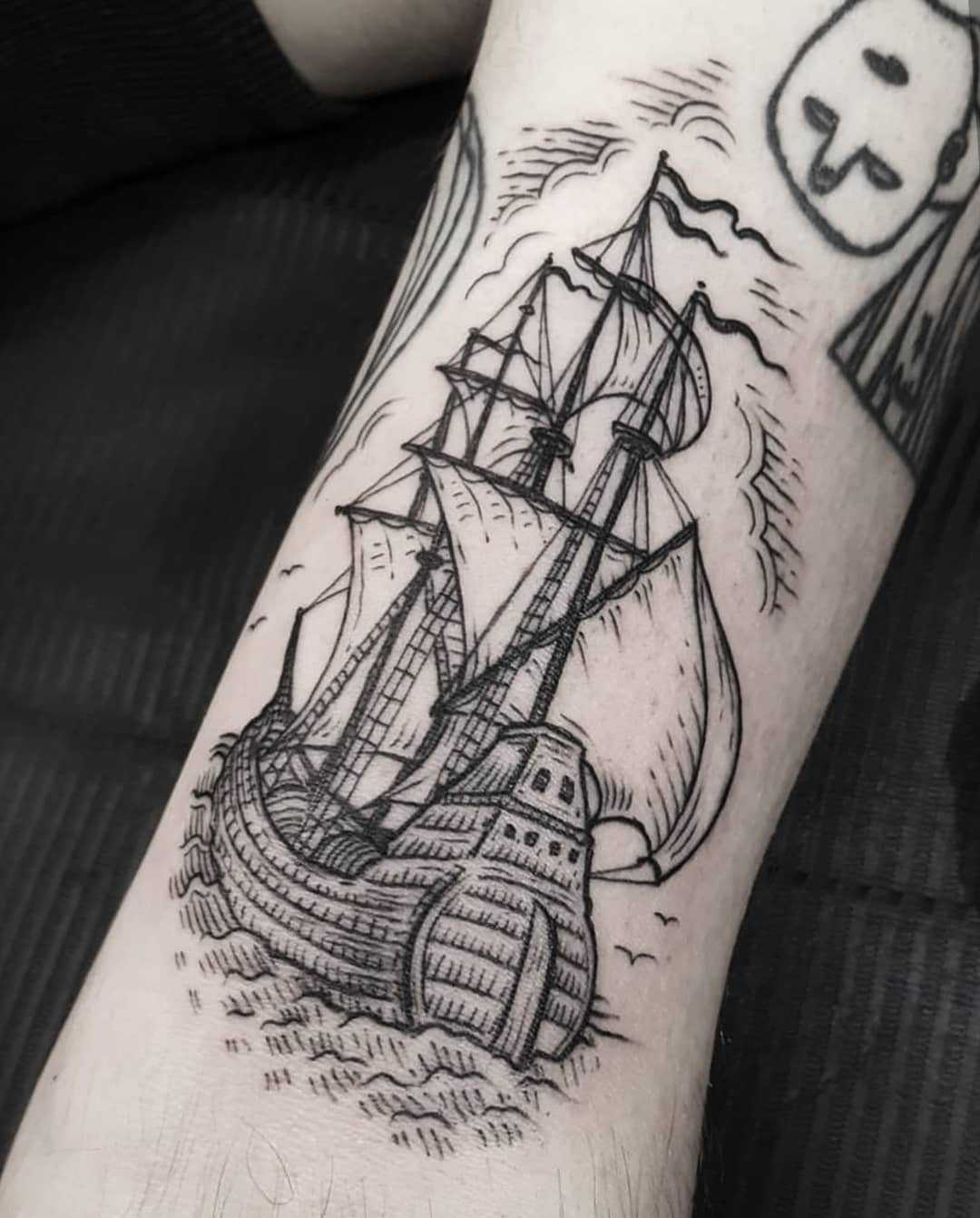 Blackwork ship tattoo on the arm