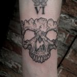 Blackwork skull fragment tattoo