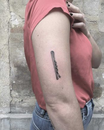 Bobby pin tattoo on the arm
