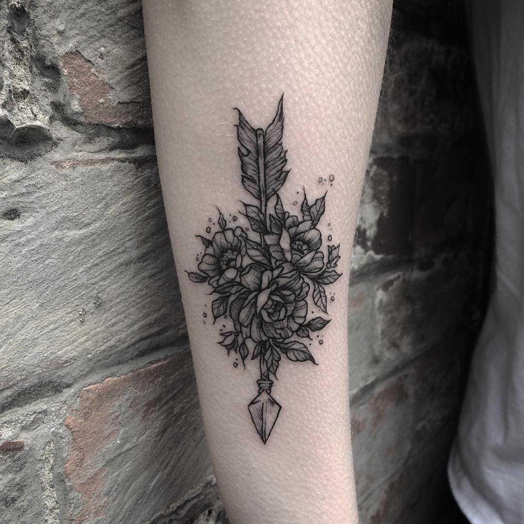 Botanical arrow tattoo