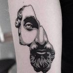 Broken antique head bust tattoo