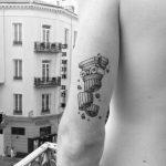 Broken pillar tattoo on the triceps