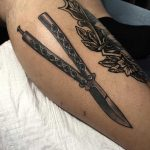 Butterfly knife tattoo on the calf