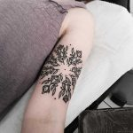 Circular floral pattern tattoo