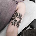 Circular floral pattern tattoo